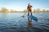 stand up paddling on a lake in Colorado