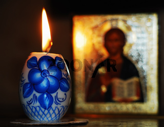 candle and orthodoxy icon