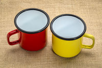 metal enamel cups on burlap