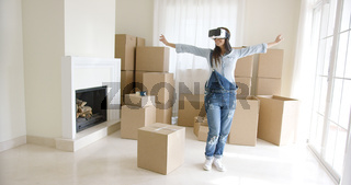 Happy young woman enjoying her VR headset