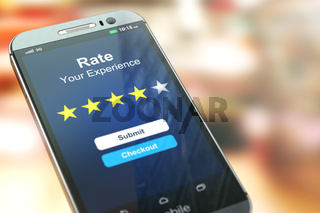 Smartphone or mobile phone with text rate your experience on the screen.  Online feedback rating and review concept.