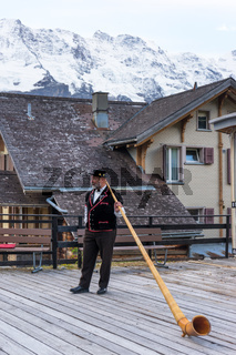 alphorn performance near alpes mountains