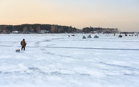 Winter fishing in Siberia - fisher's tents on ice of Ob reservoir in Novosibirsk, Russia