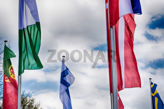Europe countries flags against a blue sky