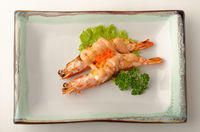 Two grilled shrimped served with fish roe.