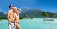 happy couple on over bora bora island beach