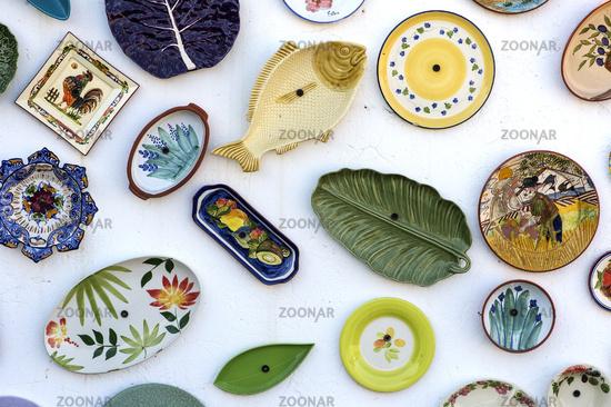 ceramics at the wall of the pottery shop Artesanato A Mo, Sagres, Algarve, Portugal