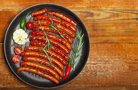 Wiener Sausages in a pan on wooden background