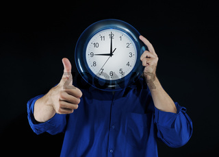 man holds hours