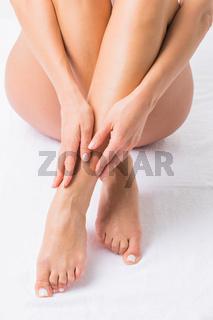 Woman touching legs