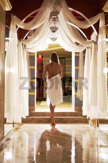 Sexy blonde posing in luxurious sauna interior