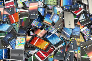 Choose mobile phone. Heap of the different smartphones with different application on the screen. Modern technology concept background.
