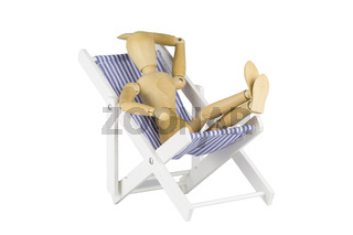 Wooden mannequin on a beach chair