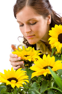 Portrait of beautiful woman with sunflowers
