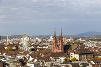 Basel skyline view with Minster and ferris wheel