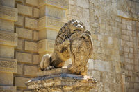 Statue of a lion holding the shield with the coats of arms near Main Gate. Mdina. Malta