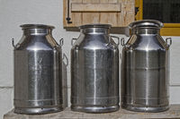 Milk cans in front of the mountain hut