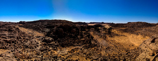 Aerial panoramic view to El Berdj mountain and erg gorge in Tassili nAjjer national park, Algeria