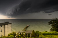 A thunderstorm rolls across the Baltic Sea in front of the island of Rügen.