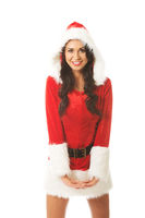Attractive santa woman standing astride and inclined, looking to the camera
