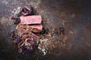 Barbecue dry aged Kobe rib eye steak as close-up on a board