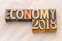 economy 2018 word abstract in wood type