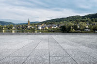 empty floor with village near hill in europe
