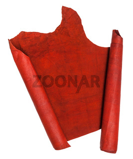 unrolled scroll from red suede isolated