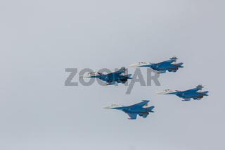 Fighter Sukhoi Su-27 show aerobatics at an airshow Russian Knights.