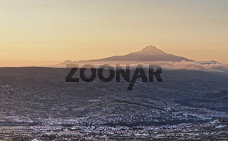 The sleeping giant, view of the volcano Erciyes near Kayseri in Anatolia, Turkey, with the villages of Cappadocia in the foreground, aerial photos.