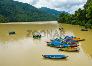 Small boats on Phewa Lake in Pokhara