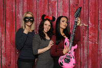 young women face a photo box and have fun
