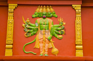 Colorful idol of Lord Hanuman on the outer wall of a temple, on the way to Kanchipuram, Tamil Nadu, India