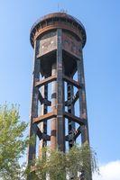 old rusty water tower and clear blue sky