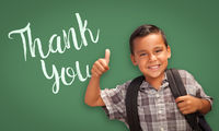 Hispanic Boy with Thumbs Up in Front of Chalk Board with Thank You Written On It