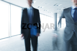 Blurry portrait of walking businessman