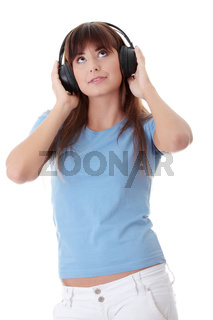Happy teen girl listening to the music