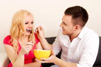 Lovely couple eating together from one bowl