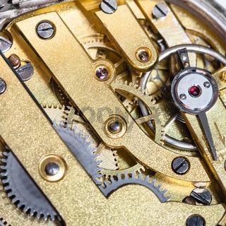brass clockwork of old mechanical watch