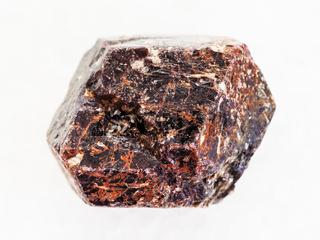 rough crystal of dravite tourmaline on white