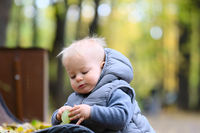 One year old baby boy in autumn park