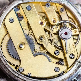 brass clockwork of old mechanical pocket watch