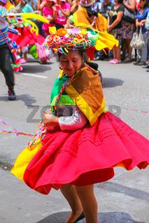 Local woman performing during Festival of the Virgin de la Candelaria in Lima, Peru.