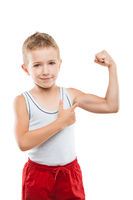 Smiling sport child boy showing hand biceps muscles strength