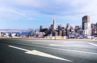 empty road with cityscape and skyline of san francisco at sunrise