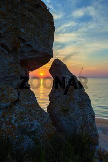 Sunset over the Sea of Azov on Generals beach. Karalar regional landscape park in Crimea.