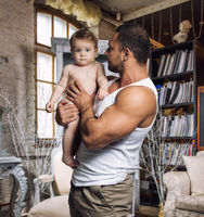 Athletic father with daughter at home