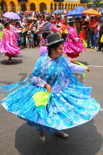Local woman dancing during Festival of the Virgin de la Candelaria in Lima, Peru
