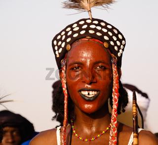 Man dancing Yaake dance and sing at Guerewol festival in InGall village, Agadez, Niger