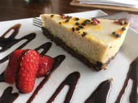 AIP Paleo Cashew Milk cheesecake on a plate in wellness cafe
